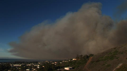 Long shot of a cloud of wildfire smoke hovering over... Stock Video Footage
