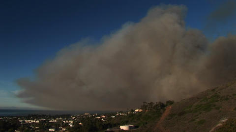 Long shot of a cloud of wildfire smoke hovering over Ventura, California Footage
