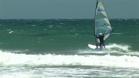 Following shot of kite surfers off the California coast Footage