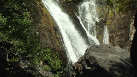 Pan-up of a waterfall in Big Sur, California Footage