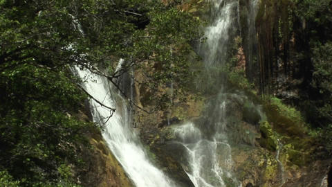 Pan-up of a waterfall in Big Sur, California Stock Video Footage