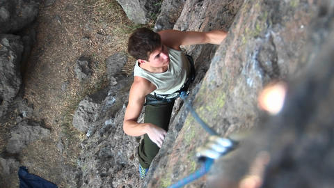 Bird's-eye shot of a rock climber scaling a cliff face Stock Video Footage