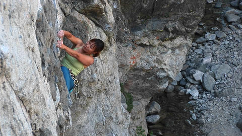 Bird's-eye shot of a rock climber struggling to pull... Stock Video Footage