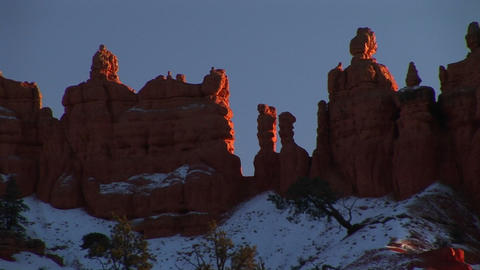 Medium-shot of rock formations in Bryce Canyon National Park dusted in snow Footage