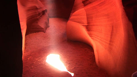 Pan-up of a shaft of light illuminating the interior of a... Stock Video Footage