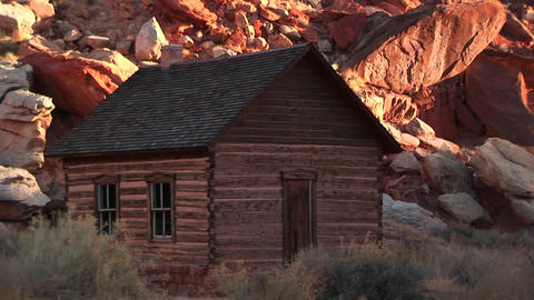 Slow pan-up of a historic log one-room schoolhouse in... Stock Video Footage