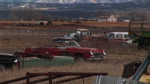 Medium shot of junked, rusting automobiles in a Colorado... Stock Video Footage