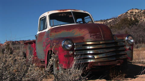 Wide shot of rusted old pickup truck littering the Utah desert Footage