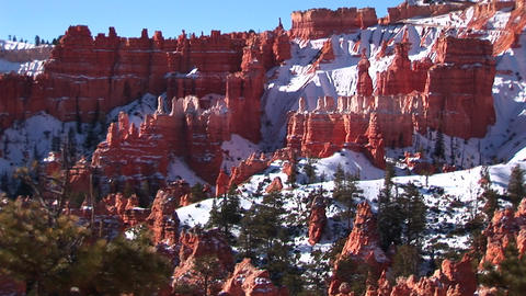Wide shot of Bryce Canyon National Park with hoodoos covered by winter snow Footage