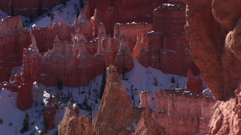 Medium static shot of the snow-capped hoodoos composing the Claron Formations in Bryce Canyon Nation Footage