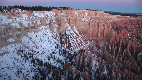 Panoramic pan-right along the snow-covered claron formations of Bryce Canyon National Park Footage