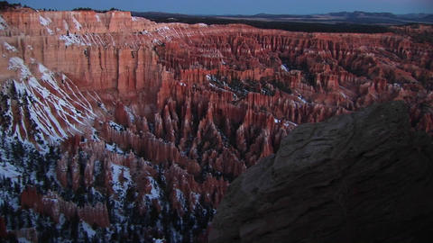 Slow pan left on snow-covered cliffs of Bryce Canyon National Park featuring the Claron Formations Footage