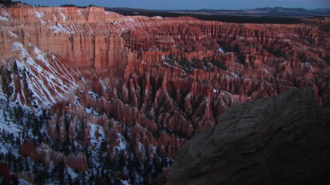 Slow pan left on snow-covered cliffs of Bryce Canyon... Stock Video Footage