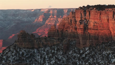 Wide shot of Grand Canyon National Park, with the layered cliffs of the north rim canyon wall soarin Footage
