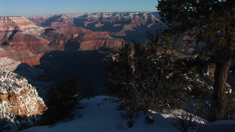 Medium wide shot of Colorado River in Grand Canyon National Park with touches of winter snow Footage