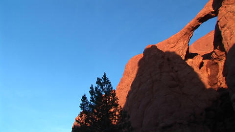 Pan-right of the Sandstone Arch in light and shadows in Kodachrome Basin in the Utah backcountry Footage
