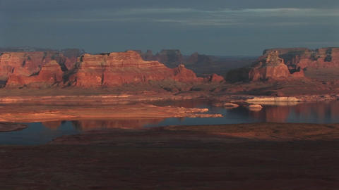 Wide shot of Lake Powell and luminous surrounding shoreline with sandstone cliffs Footage