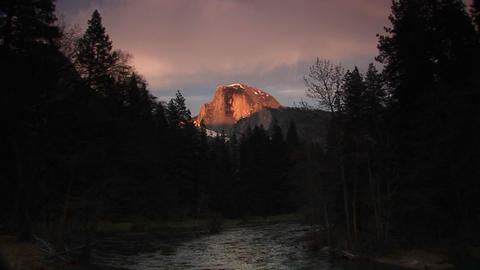 Medium shot of flowing Merced River with radiant Half... Stock Video Footage