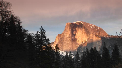 Medium wide shot of Yosemite's Half Dome during the golden-hour Live Action