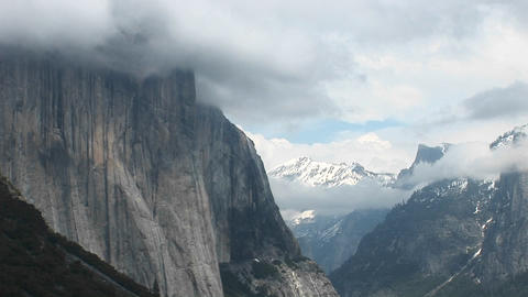 Medium-shot Yosemite Valley and El Capitan enveloped in low cloud cover Footage