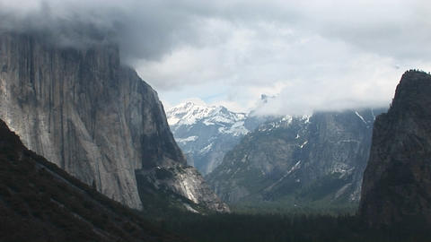 Medium-shot of Yosemite Valley cloaked in low-hanging clouds Stock Video Footage