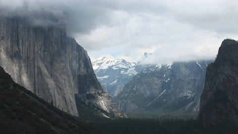 Medium-shot of Yosemite Valley cloaked in low-hanging clouds Footage