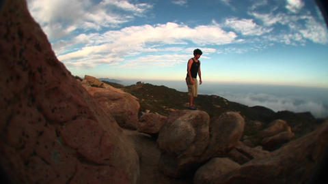 Fish-eye of a young hiker hopping from boulder to boulder... Stock Video Footage