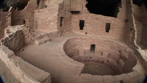 Pan-right of a circular structure amid the ruins of... Stock Video Footage