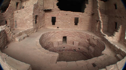 Pan-right of a circular structure amid the ruins of Native American cliff dwellings in Mesa Verde Na Footage