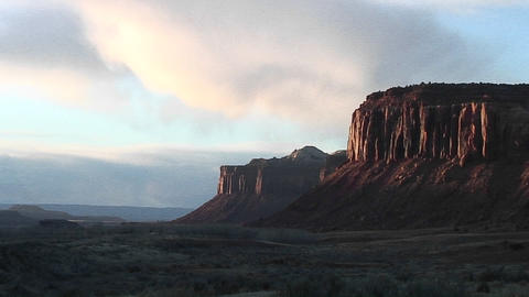 Medium-shot of reflected sunset light on the cliffs surrounding Canyonlands National Park Footage