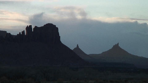 Long shot of the peak of a silhouetted North Six-Shooter in Canyonlands National Park, Utah Footage