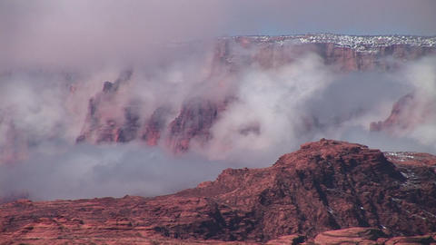 Medium-shot of fog slowly enveloping cliffs around Lake Powell, Arizona Footage