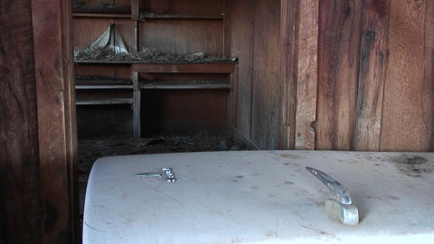 Medium-shot of the interior of an old abandoned farm house in the Utah Desert Footage