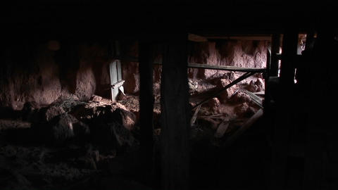 A catacomb or tomb or abandoned mining shaft Stock Video Footage