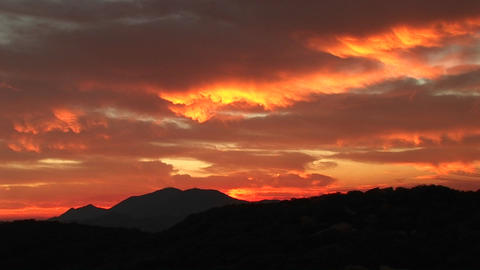 Medium-shot of a fiery sunset over the Santa Barbara Mountains, California Footage