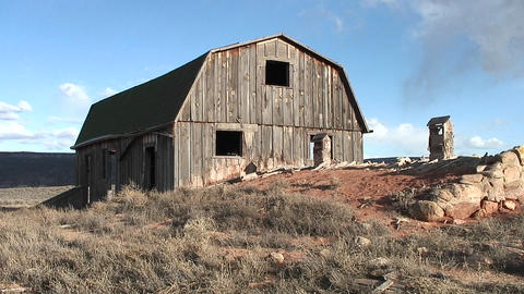 Medium-shot of a weathered, abandoned barn outside Moab, Utah Footage