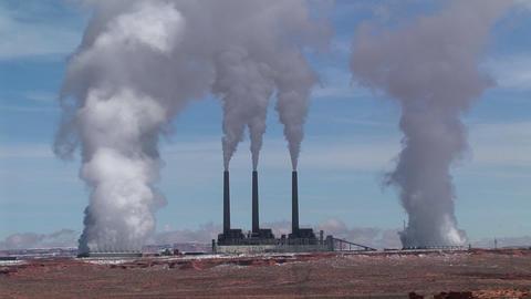 Medium-shot of a factory in the Arizona desert, belching... Stock Video Footage
