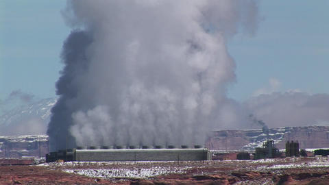 Medium-shot of a factory in the Arizona Desert emitting... Stock Video Footage