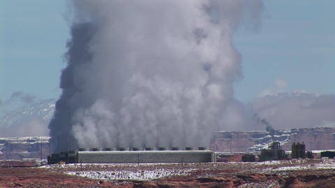 Medium-shot of a factory in the Arizona Desert emitting... Stock Video Footage