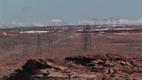 High-angle of electrical towers stretching across an... Stock Video Footage