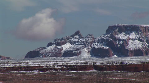 Medium-shot of Arizona desert cliffs dusted with light snow Stock Video Footage