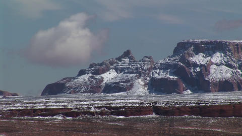 Medium-shot of Arizona desert cliffs dusted with light snow Footage