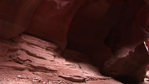 Tilt-up of a rock-climber making her way up a sheer... Stock Video Footage