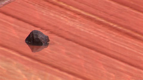 Medium-shot of a rock sitting in the midst of shimmering... Stock Video Footage