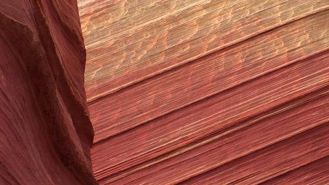 Pan-down of the sandstone walls of a desert canyon Stock Video Footage