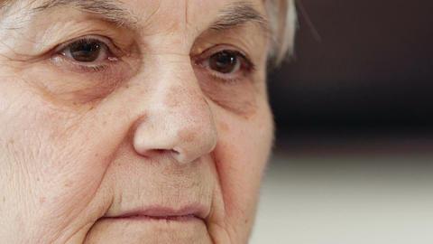 sad grandmother looks intensely around Footage