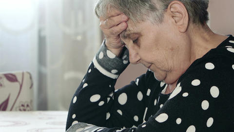 Worried grand mother thinks sadly Live Action
