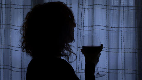 young woman waits her lover drinking wine in a dark room, secret relation Footage