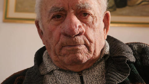 pensioner sadness: old man moved looking the camera Live Action