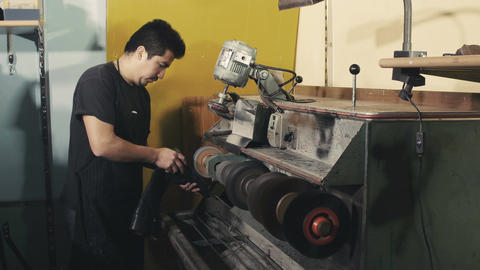Shoemaker repairing the heel leather boots Footage